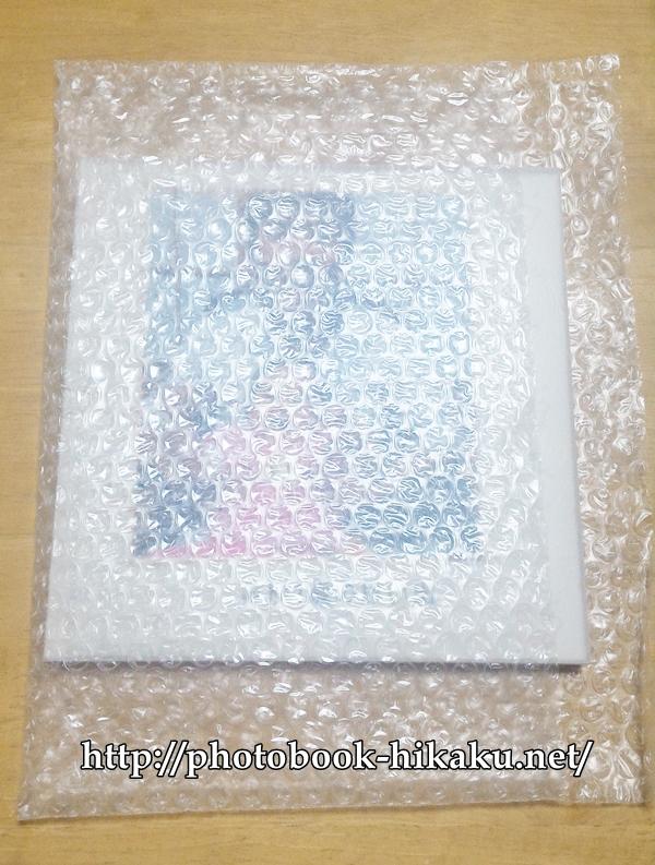 フォトレボのフォトブックにプチプチで梱包されている画像